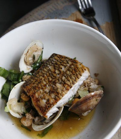 Simple but impressive main course: Black Bass with chickpeas, clams, and chorizo. Yum. #saveur #dinnerparty