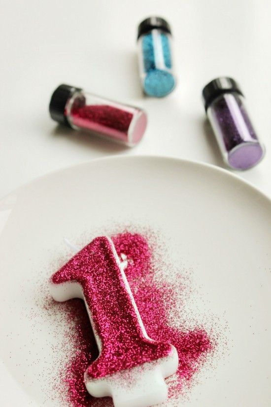 DIY - using edible glitter to decorate your number candle the way you want it! Edible glitter used because we know how glitter gets everywhere... This way you don't care if any gets on the cake