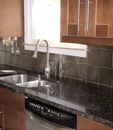kitchen with metal backsplash stainless steel backsplash black countertops i how 6531