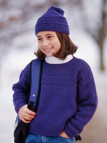 Rows of decorative stitches in pretty diamond and check patterns adorn this wool sweater and cap set. Knit in blueberry-color yarn, they're perfect to wear with jeans.