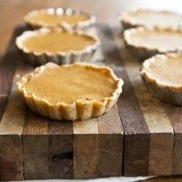 [ Recipe: Mini Pumpkin Tarts (with homemade pumpkin puree) ] made with: whole wheat pastry flour, salt, butter, cream cheese, water. For filling: pie pumpkin, maple syrup, cinnamon, ginger, nutmeg, cloves, egg, heavy cream. ~ from Naturally Ella