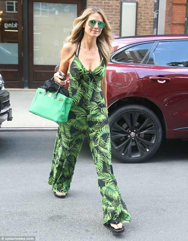 8f5dd1d58cf Sweet summertime  Heidi Klum was giving off tropical vacation vibes on  Monday as she walke.