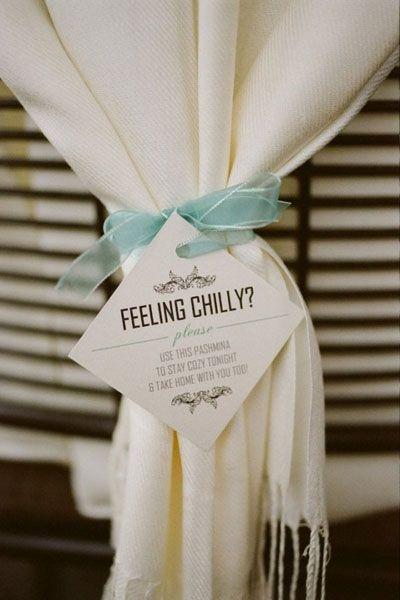 I love the idea of pashmina scarves as favors. Very cute if you drape them around the chair backs. | DIY Wedding Decor | Unique Wedding Favor Ideas | Winter Wedding