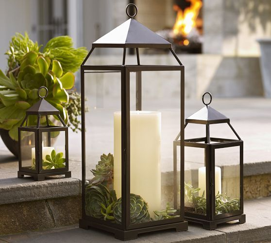 Malta Lanterns - Bronze finish | Pottery Barn - love the greenery in the lantern along with the candle