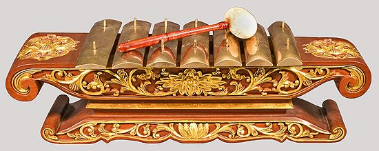 The saron is a musical instrument of Indonesia, which is used in the gamelan. It normally has seven bronze bars placed on top of a resonating frame (rancak).