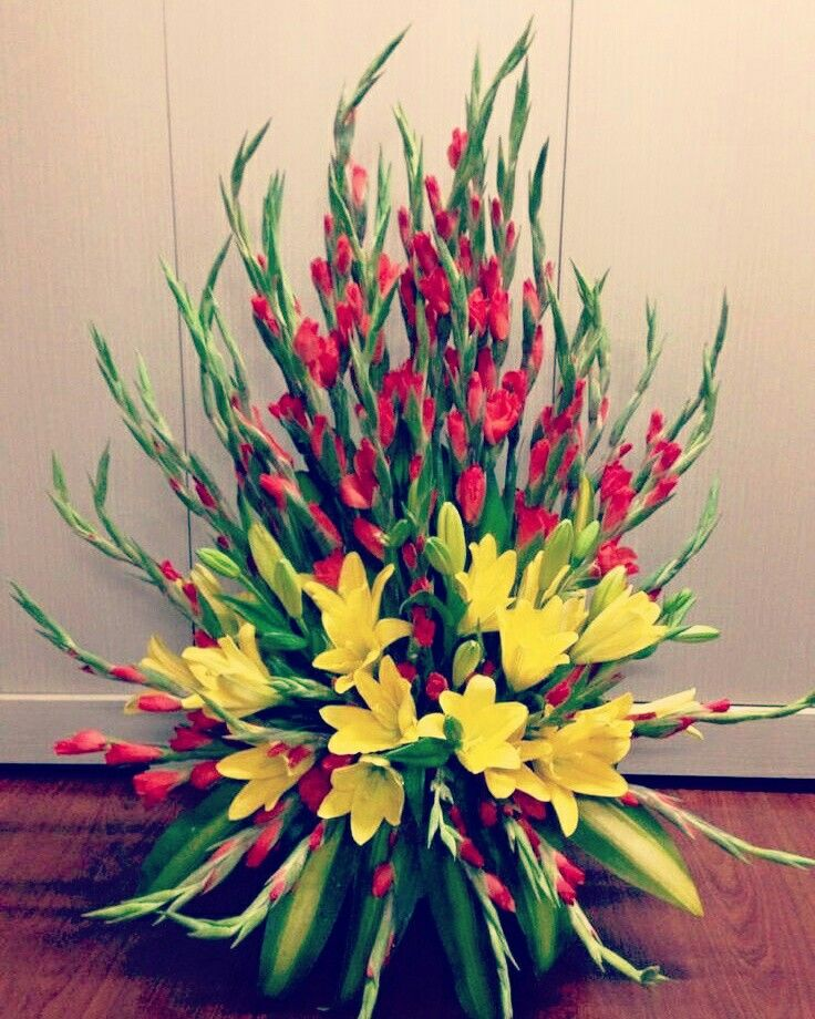 Beautiful red gladiola and yellow lilies #bouquet to enhance the beauty of your living room #InspiredFloralCreations #Kanpur