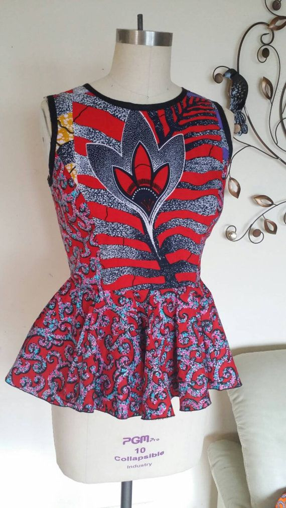 Check out this item in my Etsy shop https://www.etsy.com/listing/230600005/adom-flower-african-print-peplum-blouse