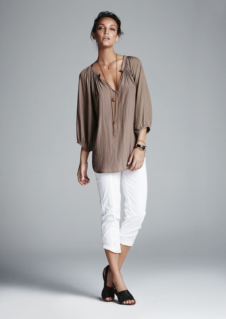 Clay escape blouse and white crop travel pant.