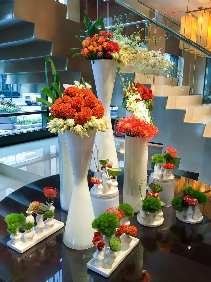 A stunning flower arrangement at Four Seasons Hotel Denver using multiple white vases.