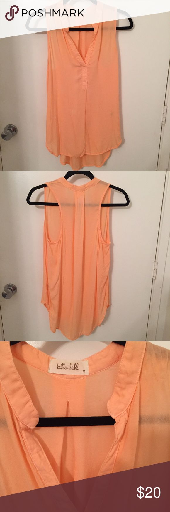 Bella Dahl Nordstrom's sleeveless top sheer peachM Bella Dahl Nordstrom's  peach colored rayon button soft tunic with slight high low fit. Beautiful top and very light and sheer. No rips or stains. Minimal a signs of wear. Ready to pair with a great pair of jeans or loose fit Bella Dahl pants. Size M. Stock photo shows style in different color. Bella Dahl Tops