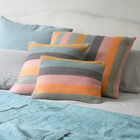 HA' PENNY CUSHION - These rainbow rascals are hand-woven in Varanasi from 100% wool. The reverse stitching detail is enough to make our mouths water...YUM.