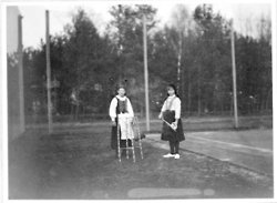 Grand Duchess Anastasia with a Polish peasant girl during a game of tennis