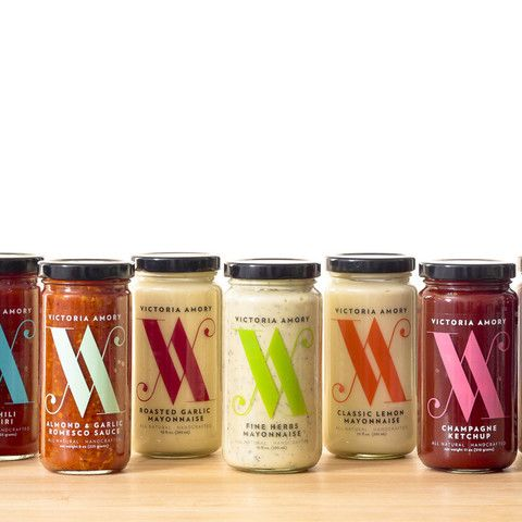 This is it! The entire Victoria Amory Condiment Collection for you to try. Inspired by the flavors and aromas of the Mediterranean coastline, this all-natural collection brings the traditional flavors of the kitchen to your table. Includes:   1 Roasted Garlic Mayonnaise,  1 Classic Lemon Mayonnaise,  1 Fine Herbs Mayonnaise,  1 Champagne Ketchup , 1 Sherry Ketchup,  1 Smokey BBQ Ketchup,  1 Roasted Pepper Piri Piri , 1 Green Chili Piri Piri,  1 Almond & Garlic Romesco Sauce.