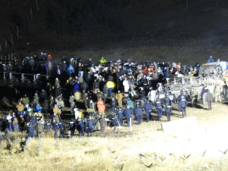 In this image provided by Morton County Sheriff's Department, law enforcement and protesters clash near the site of the Dakota Access pipeline on Sunday, Nov. 20, 2016, in Cannon Ball, N.D. The clash came as protesters sought to push past a bridge on a state highway that had been blockaded since late October, according to the Morton County Sheriff's Office. via AP