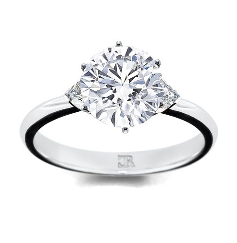 A large brilliant cut is flanked by half hidden trilliant cut diamond shoulders. A finer solitaire, contemporary and fully hand-made. Available in 18 carat