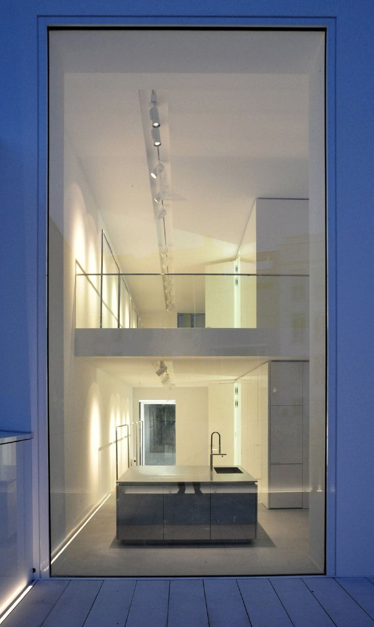 Extra large window giving the architecture a sense of generousness. The Oberwall Townhouse/Runderholz flagshipstore in Berlin by Apool.