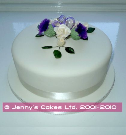 A single tier wedding cake with simple flower decoration for Simple single