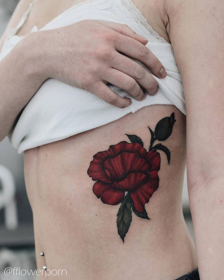 Illustrative poppy tattoo on Kate's left ribcage.