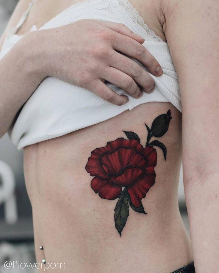 Illustrative poppy tattoo on Kate's left ribcage.