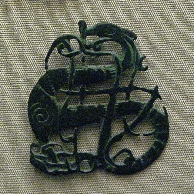 Eleventh century Viking brooch with an Urnes style dragon design. From Vaga…