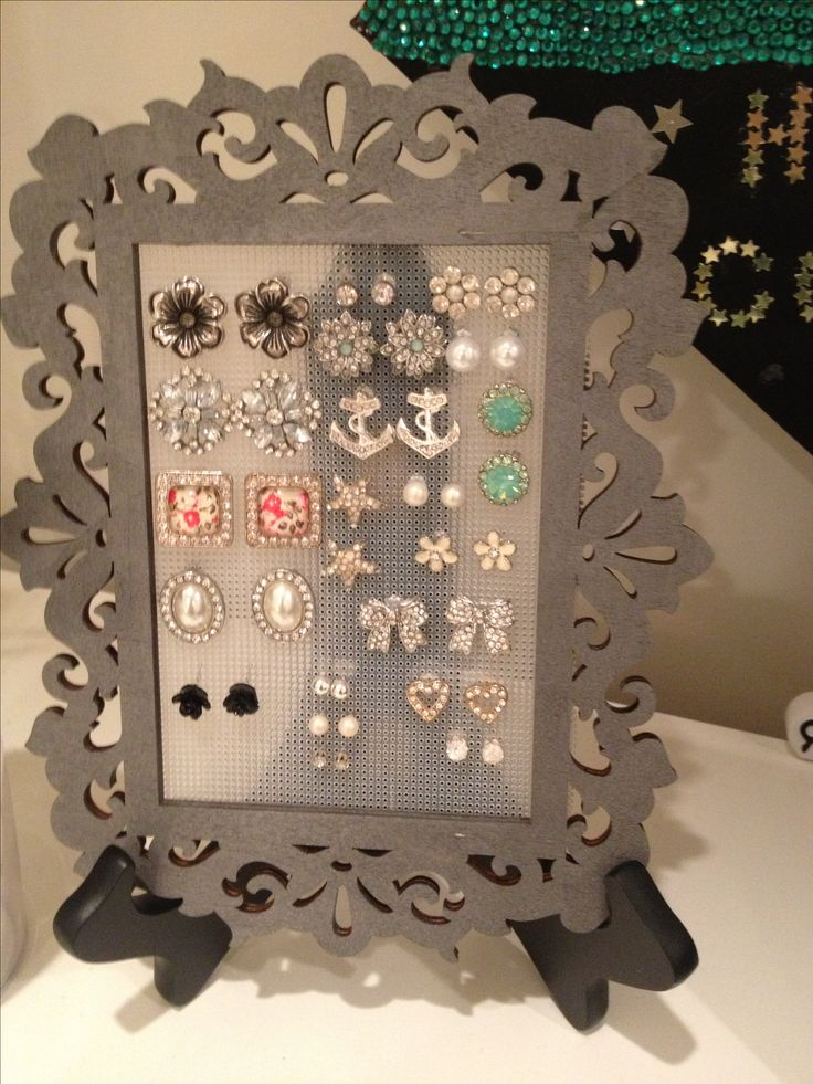 Earring holder  -Paint a wooden frame color of choice, staple earring mesh to back (can buy at any craft store), place on a small easel stand and that's it! - perfect earring holder.