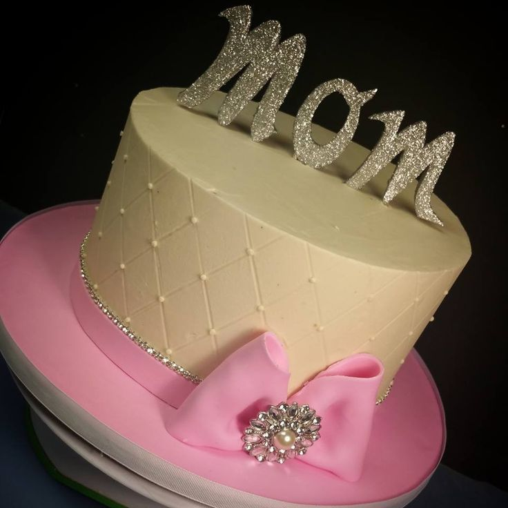 Could do this using white frosting, metallic gold ribbon and gold glitter 50 or 2 store bought large white flowers