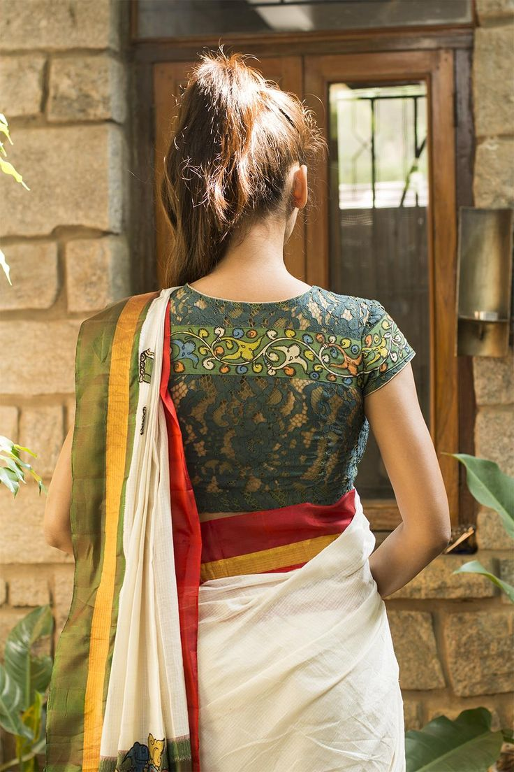 A simple allover green cotton lace blouse with a Kalamkari border running across. With a cool peekaboo back in lace, a lovely addition to any wardrobe.We figured that this was such a versatile blouse! Pair it in any number of ways with any complementing color or contrast for some kalamkari styling. #kalamkari #saree #india #blouse #houseofblouse