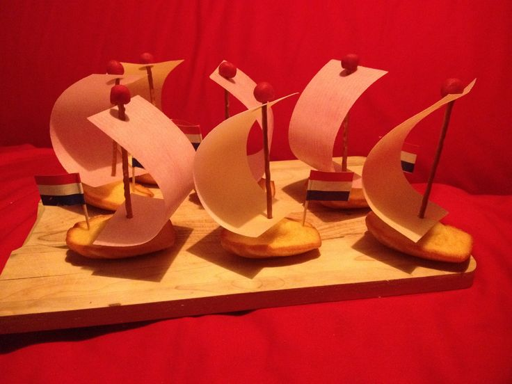 Madeleine cakes boats with eating paper sail, salty stick mast and marzipan top. Don't forget the flag!