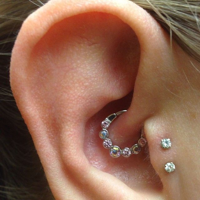Lynx with Mercury Mist and Pink CZ in Daith. Double Tragus with Double Diamonds