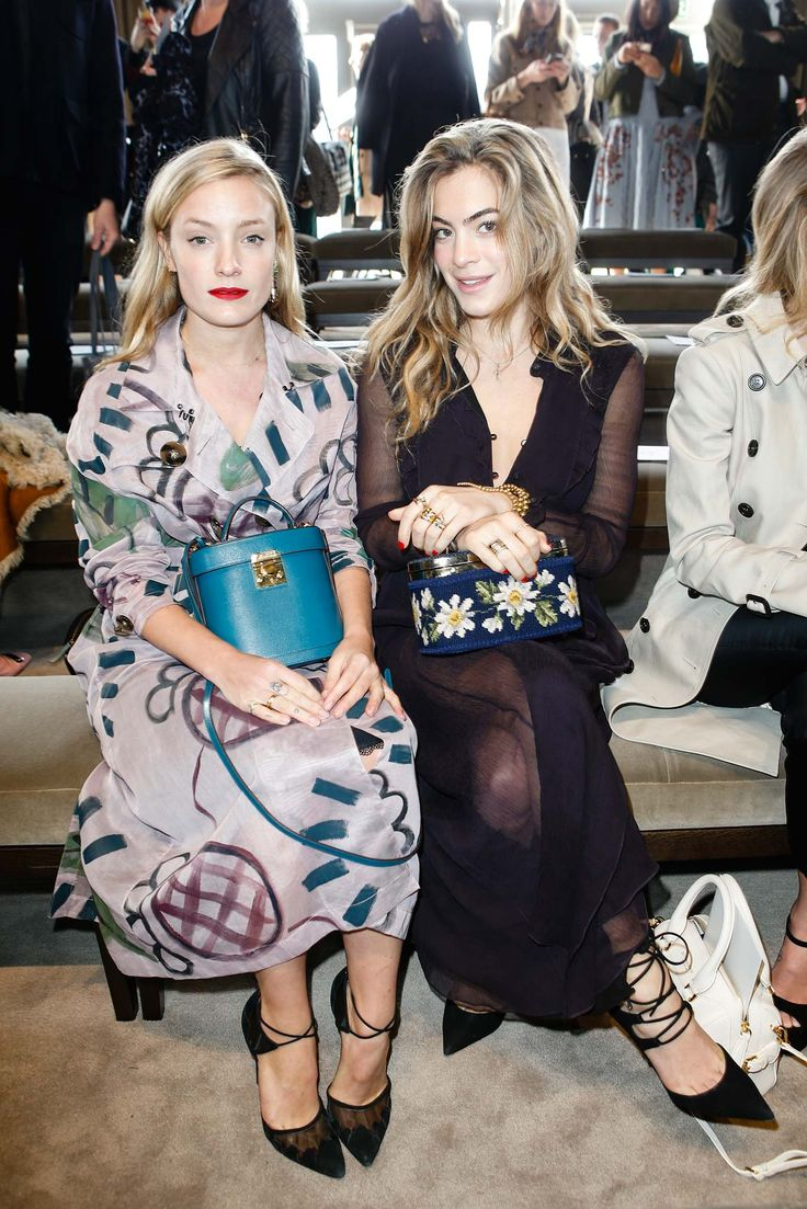 Love their bright cases! Kate Foley and Chelsea Leyland - Burberry Prorsum Fall 2015 Ready-to-Wear - Front-row