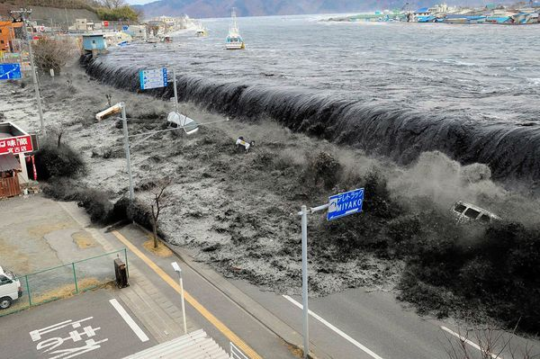 I will never forget this: A tsunami wave crashes over a street in Miyako City, Iwate Prefecture, in northeastern Japan on March 11.