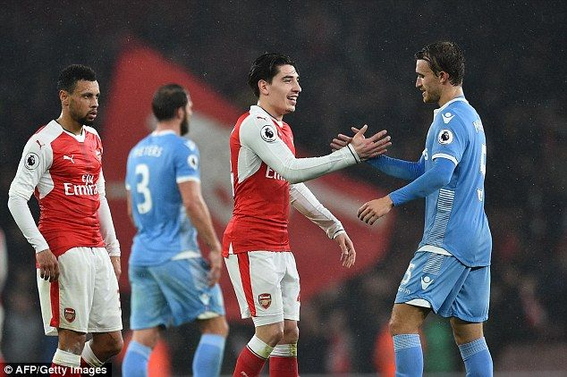 He's now at Stoke (r) where he faced fellow La Masia graduate Hector Bellerin (c) on Sunday