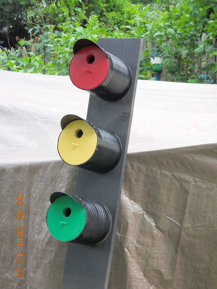 Stoplight Birdhouse made from coffee cans. Could do PB jars and twigs instead.