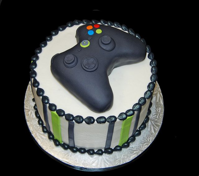 Black and neon green birthday cake topped with a video game controller for an XBOX themed party by Simply Sweets, via Flickr