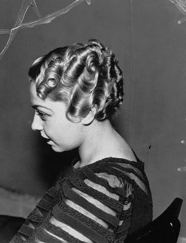 "These were called ""finger waves."" My grandmother said they would use a sugar/water mix to hold th in place."