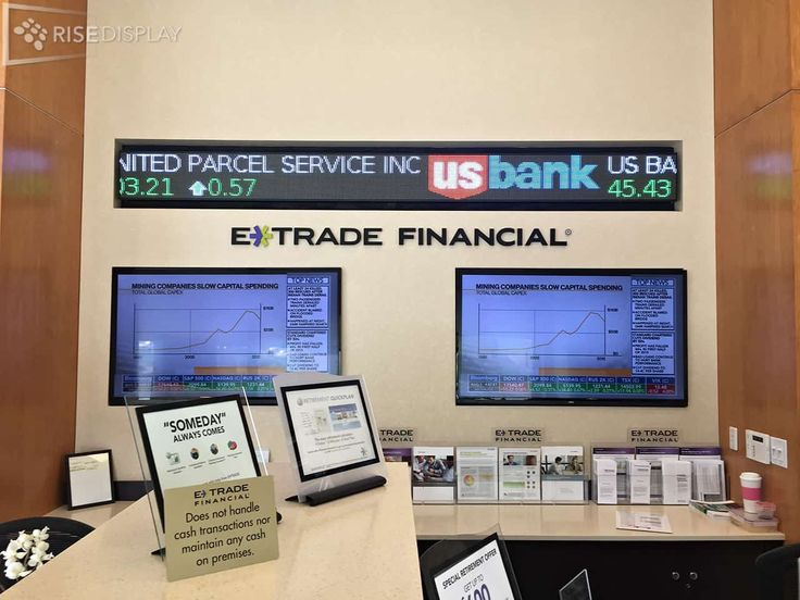 Each E*Trade Financial Ticker is 32 pixels tall and typically range from 8 to 12 feet in length.  The installation in Tampa, FL is 10 feet in length.  The Financial Ticker is located at the reception desk to attract attention from those passing by and to greet customers with the latest market updates.