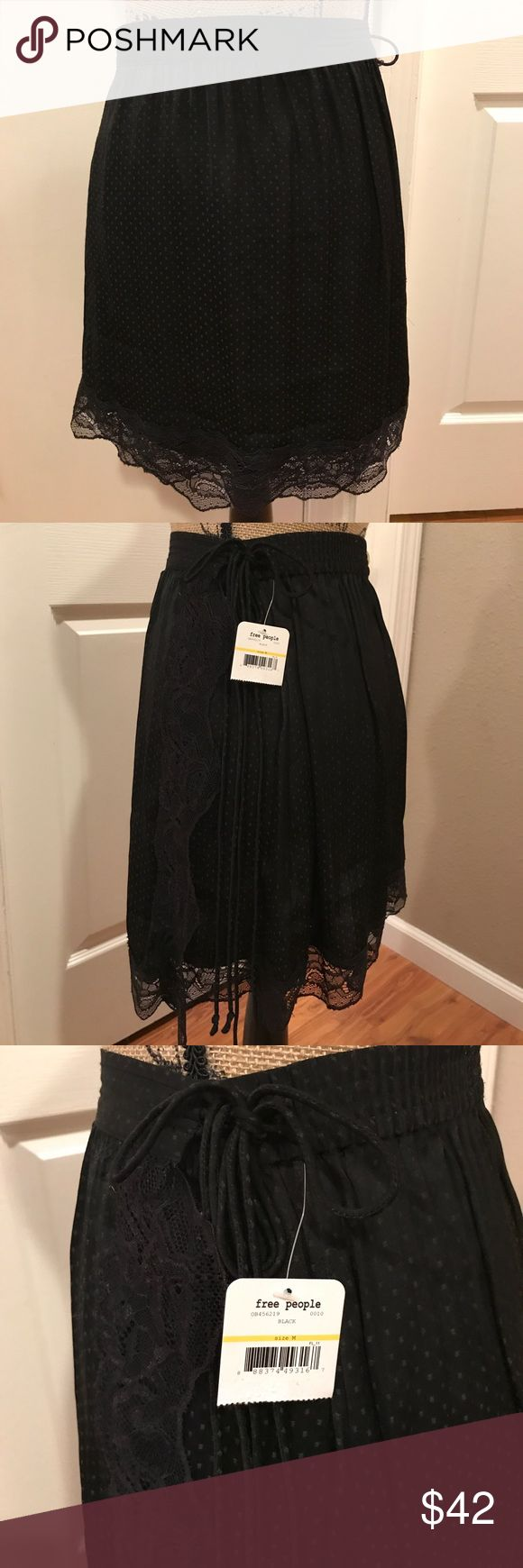  FREE PEOPLE  Tie Side Half Slip Skirt This skirt is adorable and fun!  New with tags! Free People Skirts Mini
