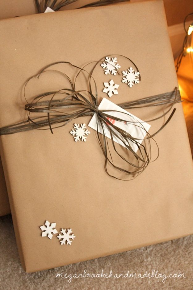 Use brown Kraft paper from the dollar store to wrap presents (I also like the blogger's idea to use 3D white snowflake stickers to accent)