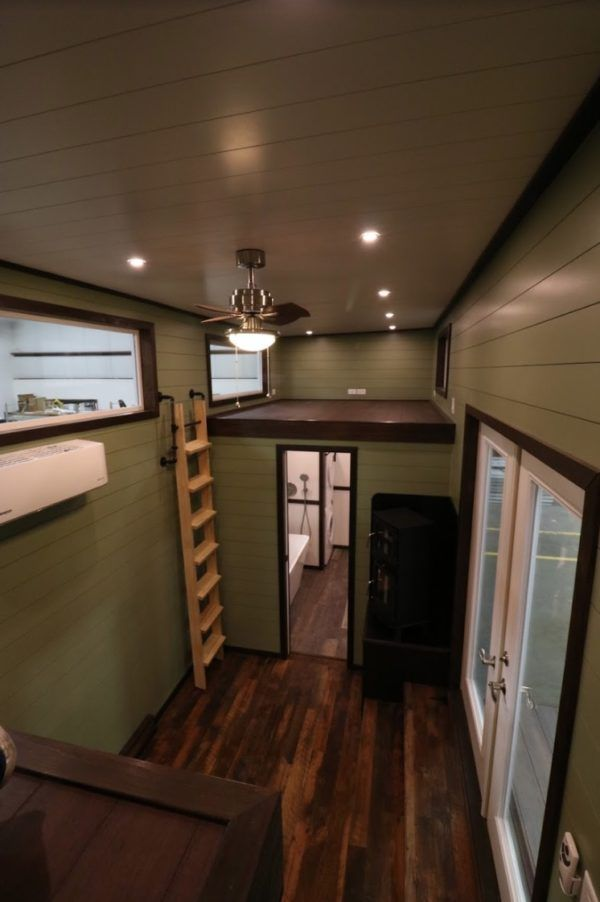 Steampunk Tiny House With Flip Down Porch Full Size Bathroom And Large Kitchen Tiny House Appliances Tiny House Tiny House Family
