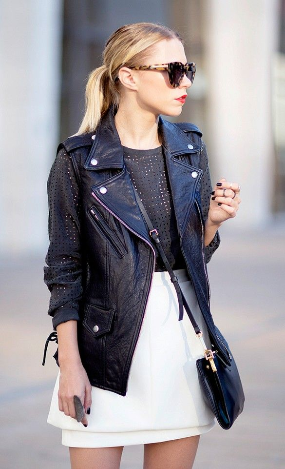 The motorcycle vest is a great layering piece. // #Style