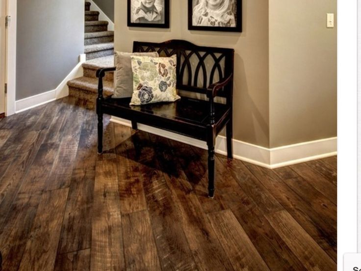 Tile that looks like hardwood.  Perfect if you have animals.....scratch resistant and beautiful!