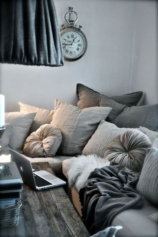 Gray Sectional sofa, weathered wood table.