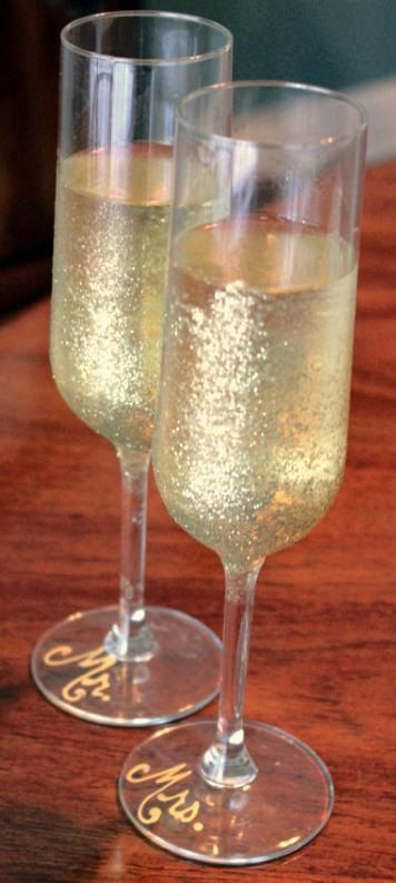 """Hand Painted Wedding Champagne Flutes: """"Pop the Bubbly"""" Toasting Flutes. $52.00, via Etsy."""