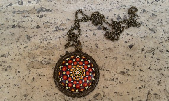 Check out this item in my Etsy shop https://www.etsy.com/listing/454515562/bronze-dotillism-art-pendant-in-warm