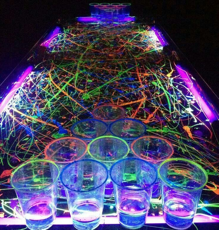 I think we'll paint the plastic table cloths w/ glow in the dark spray paint as part of the decorations.