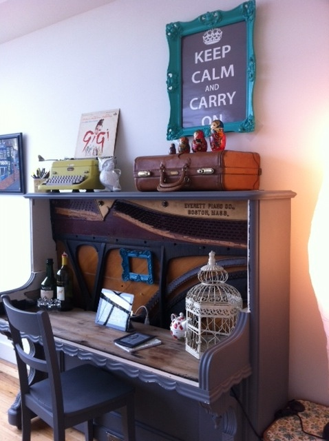 A piano, got from Craigslist for nothing, and turned into a desk. How awesome is that? Other people's crafting and re-use ideas are so amazing!