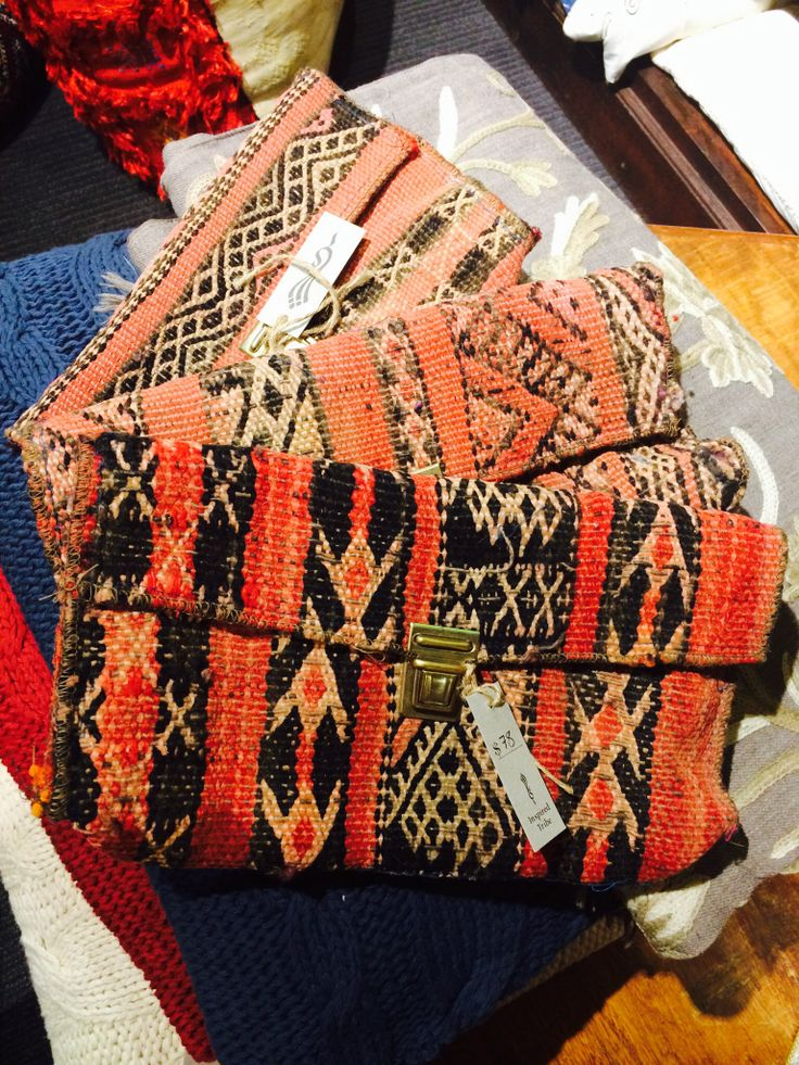 Moroccan carpet clutches