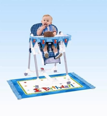 """Our Onederful Birthday Boy First Birthday High Chair Decorating Kit includes one 43"""" long paper fringe pennant banner, and one plastic floor mat with paper fringe (48"""" x 30"""")."""