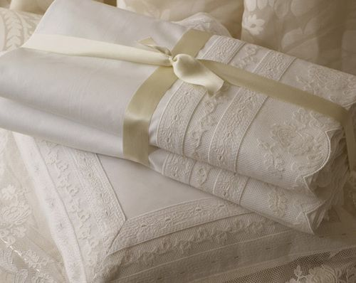 .. beautiful ivory lace bed linen wrapped in a satin bow. sigh