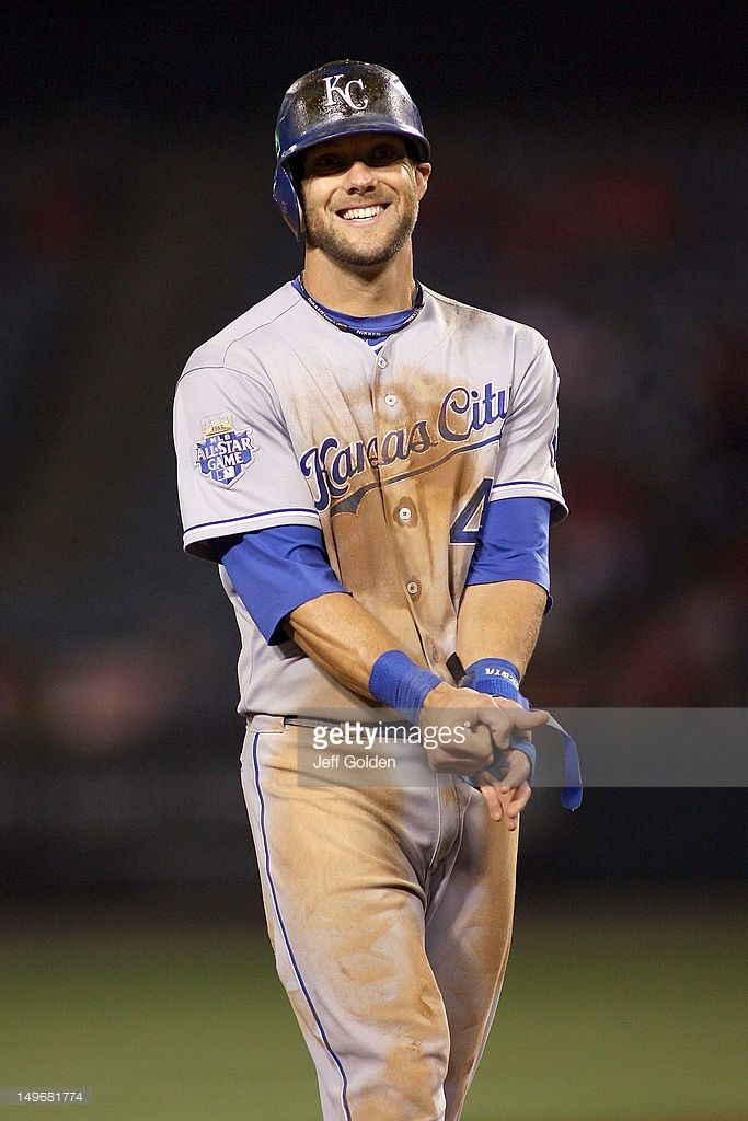 Alex Gordon of the Kansas City Royals laughs as he waits to take his position in left field against the Los Angeles Angels of Anaheim after the third out in the ninth inning at Angel Stadium of Anaheim on July 24, 2012 in Anaheim, California.